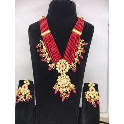 Shastta trendz Kundan Necklace & Earrings Set in Red color