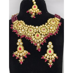 Shastta trendz Red and Gold Brass Kundan necklace set in ruby